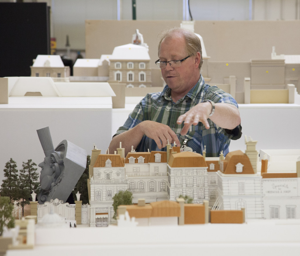 Disney Imagineer with a model of La Place de Rémy