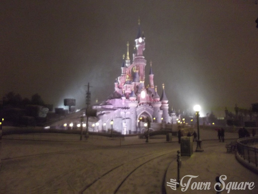 Central Plaza at Disneyland Paris at night in the snow