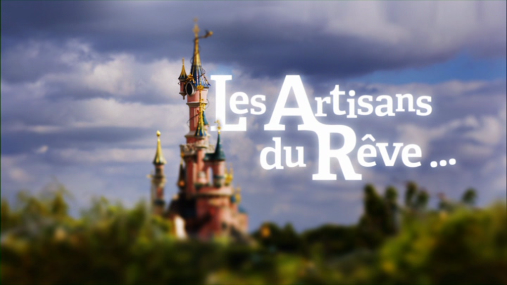 Castle with the words 'Les Artisans du Reve' next to it.