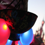 Light'Ears in front of a blurred castle at dusk