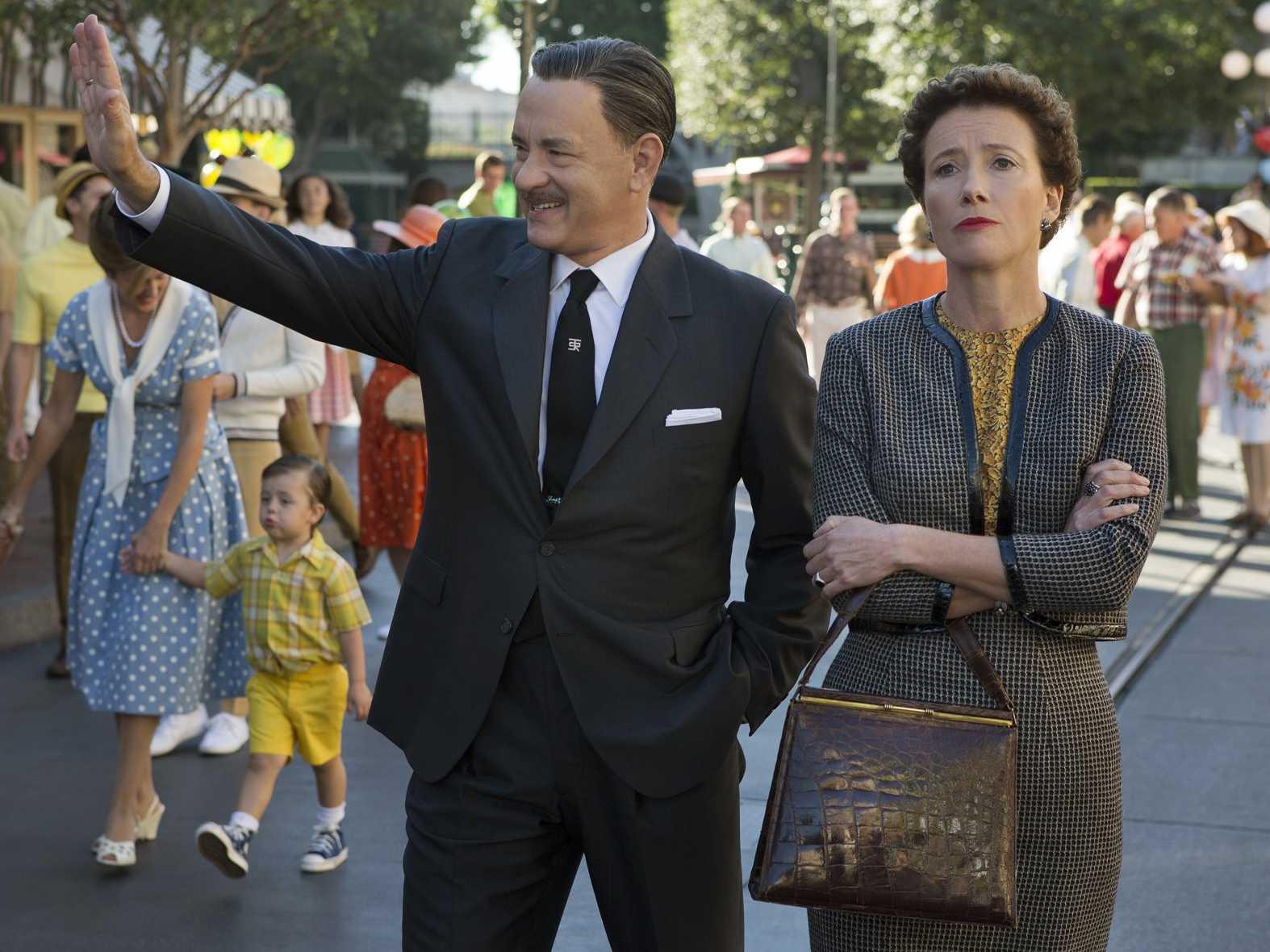 Walt Disney (Tom Hanks) and P.L. Travers (Emma Thompson) walk through Disneyland