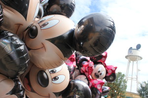 Mickey and Minnie head balloons with the Earful tower in the background