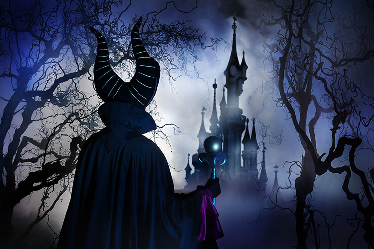 Meleficent standing in front of Sleeping Beauty castle for Halloween 2014