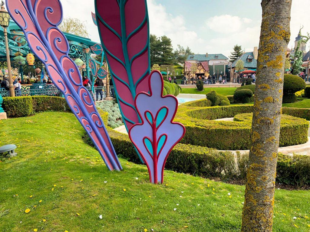 Grass around Mad Hatter's Tea Cups at Disneyland Paris
