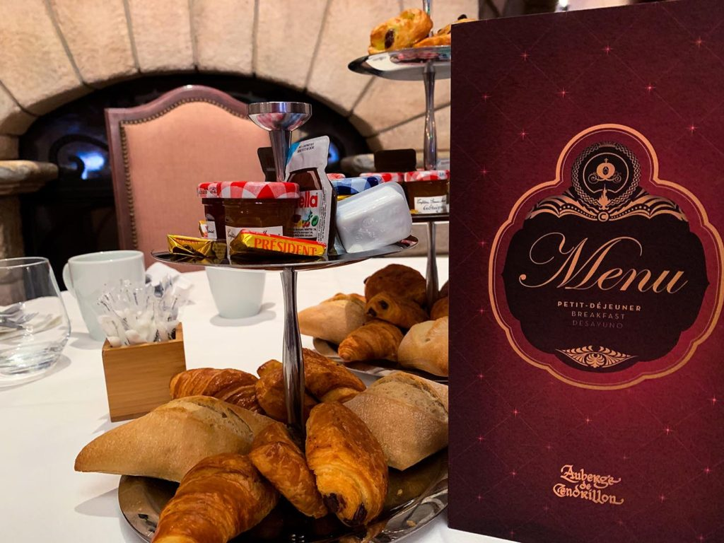 Pastries next to a menu during the Disneyland Paris Princess breakfast at the Auberge de Cendrillon