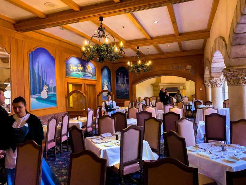 An empty dining room in a castle-like setting at the Auberge de Cendrillon in Disneyland Paris