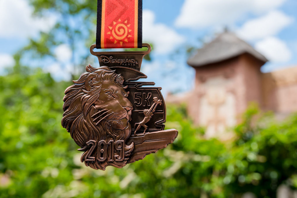 5km RunDisney Medal 2019, bronze with a Simba on it.