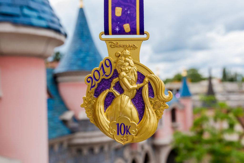 Gold and Purple medal featuring Rapunzel and Pascal