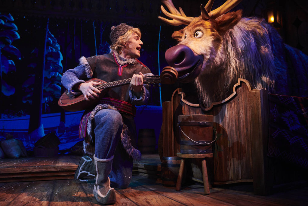 Kristoff and Sven in a barn during Frozen: A Musical Invitation